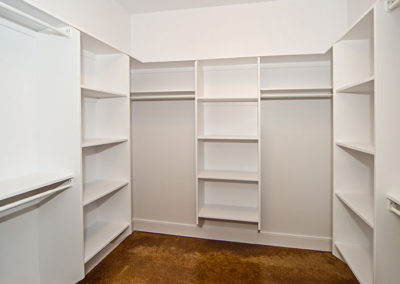 Large walk-in closet in the master bedroom of one level living
