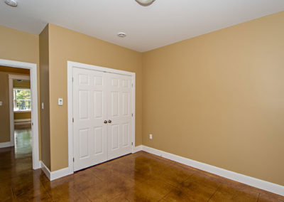 Empty second bedroom to one level living