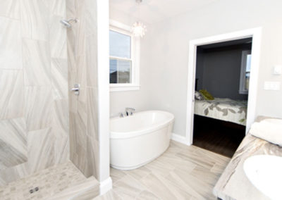 Bungalow en-suite offers fully tiled bathroom and free-standing tub for a spa like feel