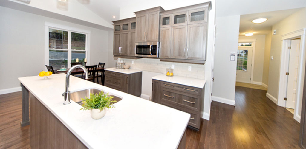 Beautiful open kitchen welcomes guests when walking in this bungalow