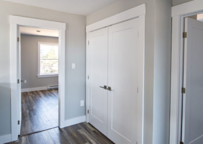 Open hallway on second floor with large bedrooms perfect for first time home buyers