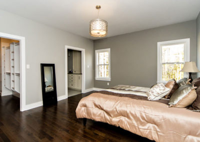 Large Master showing walk-in closet and en-suite in this turn key home