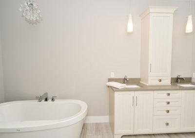 Beautiful and modern en-suite showcasing free-standing tub in turn key home