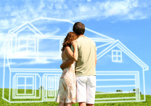 couple looking at build on your lot property with sketch of house