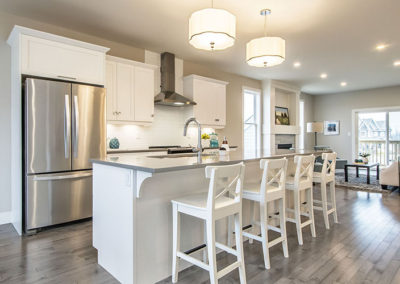 Eat-in kitchen with beautiful island featured in this bungalow floor plan