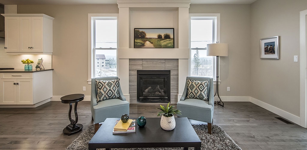 Stylish living room with fireplace offered in this bungalow floor plan