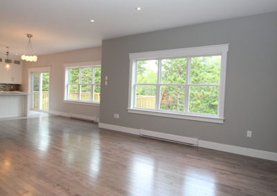 Open concept living room with hardwood and natural light with these split entry floor plans